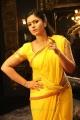Actress Poonam Bajwa Yellow Saree Photos in Aranmanai 2 Movie
