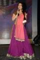 Charmi @ Potugadu Audio Launch Photos