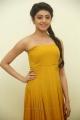 Actress Praneetha New Stills in Yellow Long Dress