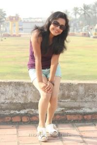 Actress Prithiksha Mythili Hot Stills in Dark Violet Top & Short Trouser