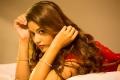 Actress Priyanka Jawalkar in Red Saree Photoshoot HD Wallpapers