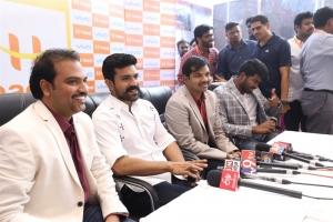 Ram Charan launches Happi Mobiles 60th Store at Vijayawada Photos