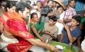 Ramcharan and Upasana serve food to pilgrims at Tirumala