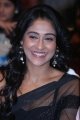 Regina Cassandra posing in Hot Black Saree at Ra Ra Krishnayya Audio Release