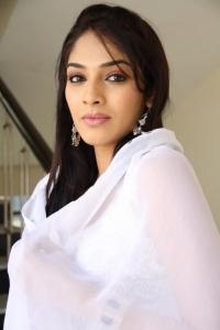 Telugu Actress Rithika New Stills in White Dress