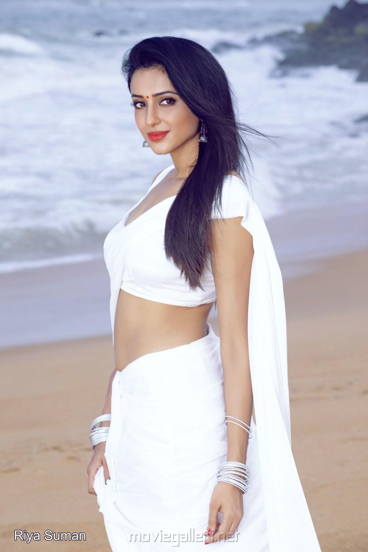 Actress Riya Suman White Saree Hot Photoshoot Stills
