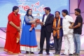 Jyothi Laxmi, NBK @ Santosham 13th Anniversary Awards 2015 Function Stills