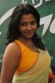 Actress Kadhal Saranya Hot in Yellow Transparent Saree with Sleeveless Blouse