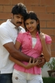 Naveen, Oviya in Scam Movie Hot Stills