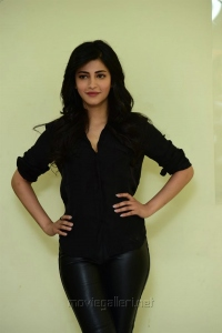 Actress Shruti Hassan in Black Shirt & Leather Jeans Photos