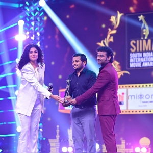 Actor-Basil-Joseph-winning-the-Best-Actor-In-A-Comedy-Role-Malayalam-award-for-the-Kettiyolaanu-Ente-Malakha-movie-@-SIIMA-Awards-2021