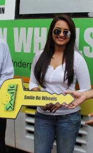 Sonakshi Sinha Hot Stills in White Dress & Blue Jeans
