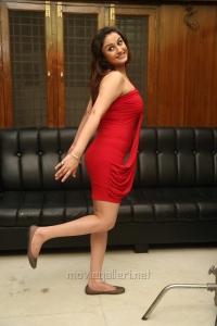 Sonia Agarwal in Red Mini Dress Hot Photoshoot Stills