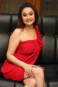 Sonia Agarwal Hot Photoshoot Stills in Mini Red Dress