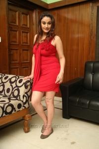 Sonia Agarwal Hot Photo Shoot Stills in Mini Red Dress