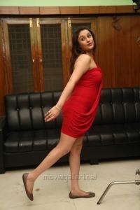 Sonia Agarwal Hot Photoshoot Stills in Red Mini Dress