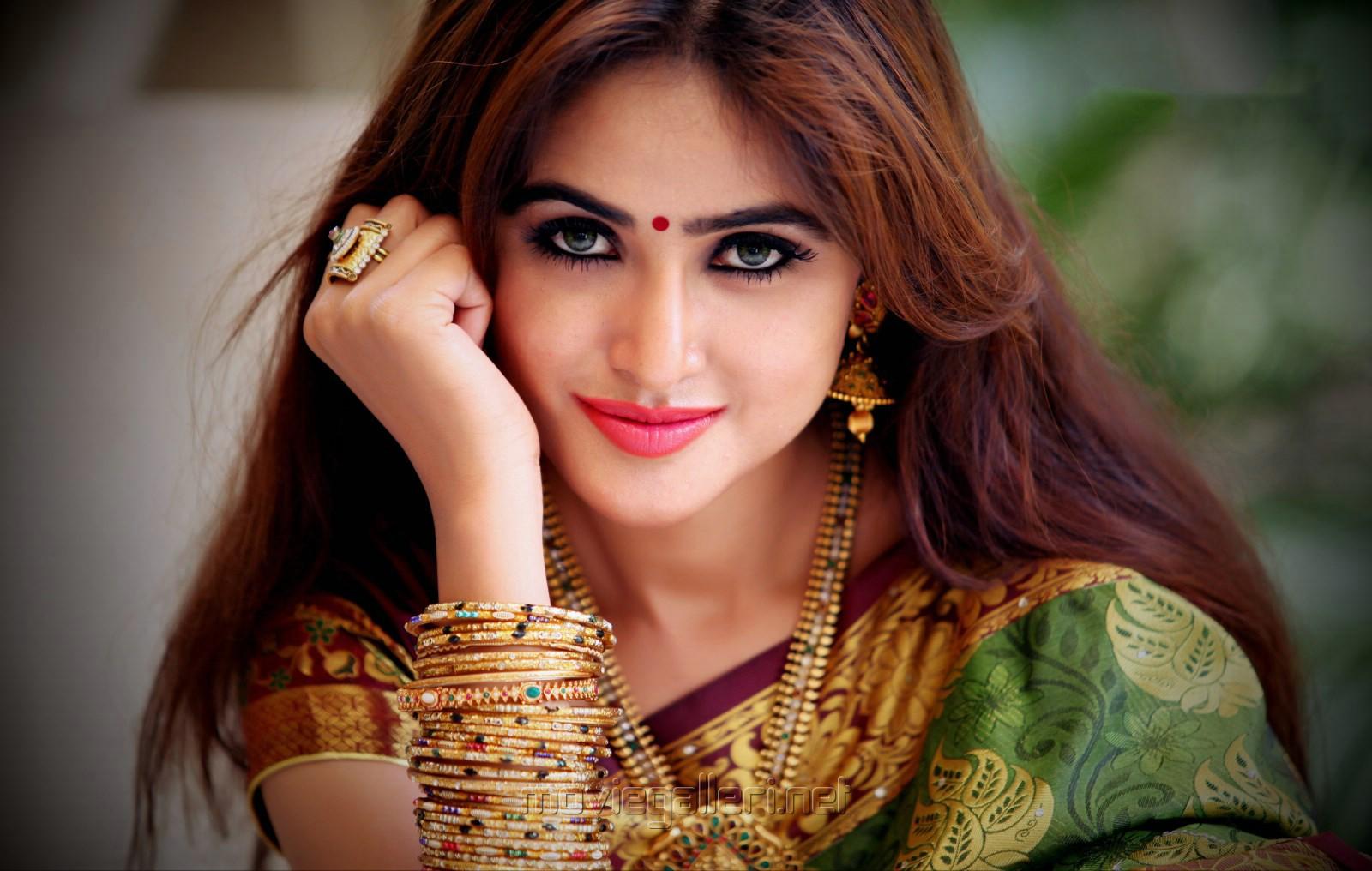 Actress Sony Charishta in Green Silk Saree Photoshoot Images