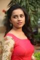 Actress Sri Divya Hot in Red Long Dress Photos