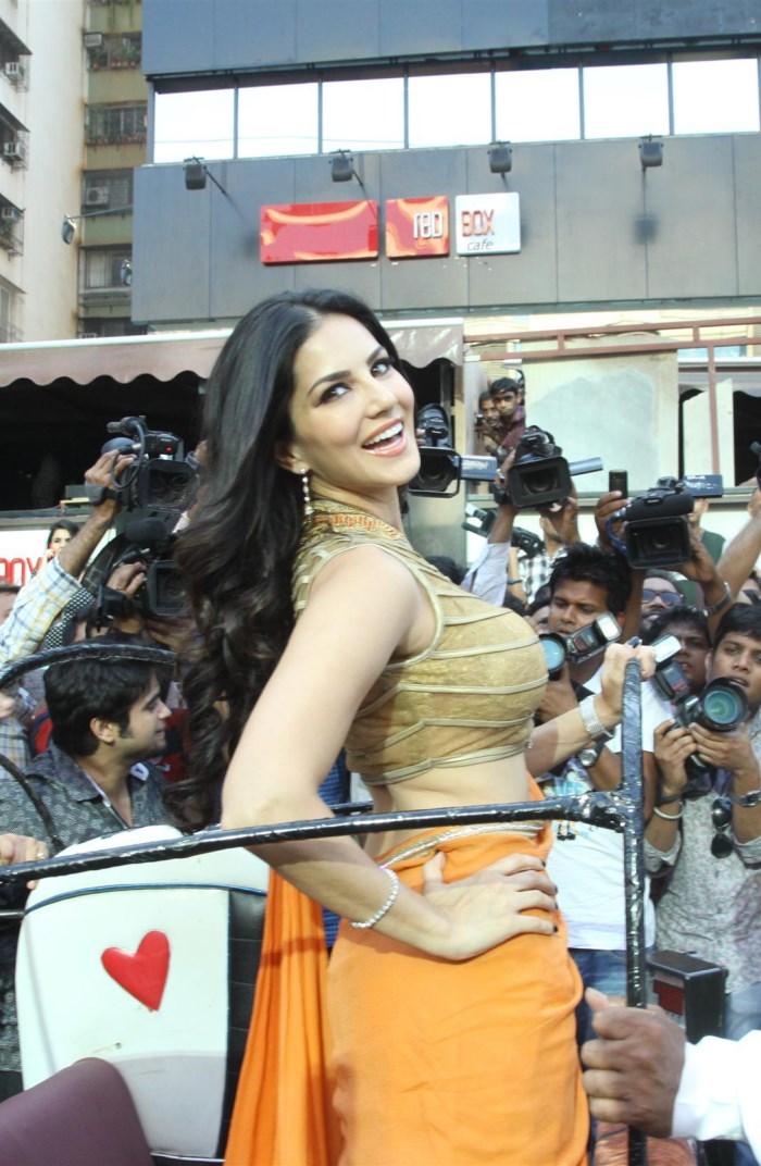Actress Sunny Leone Hot Photos in Saffron Orange Color Saree [ Gallery ...