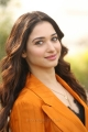 Actress Tamannaah Bhatia Pics in Dark Orange Suit @ Next Enti Movie Interview