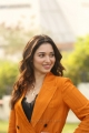 Actress Tamanna Pics in Dark Orange Suit @ Next Enti Movie Interview