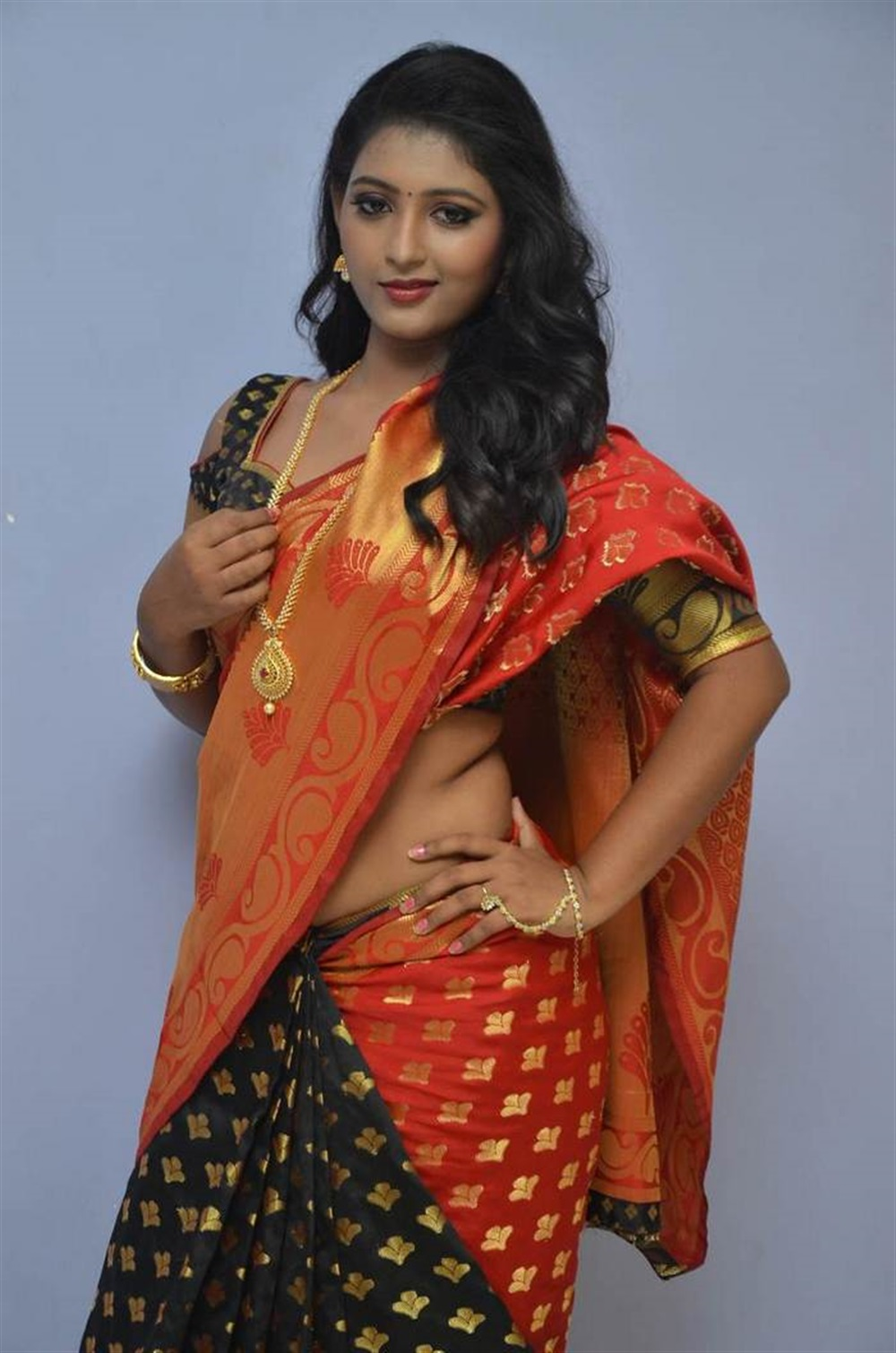 Actress Tanushka Hot Red Saree Photos