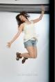 Tanvi Vyas Hot Photo Shoot in White Top & Jean Shorts Dress
