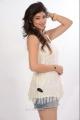 Tanvi Vyas Photo Shoot Stills in White Top & Jean Shorts Dress
