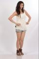 Tanvi Vyas Hot in White Top & Jean Shorts Photo Shoot Stills