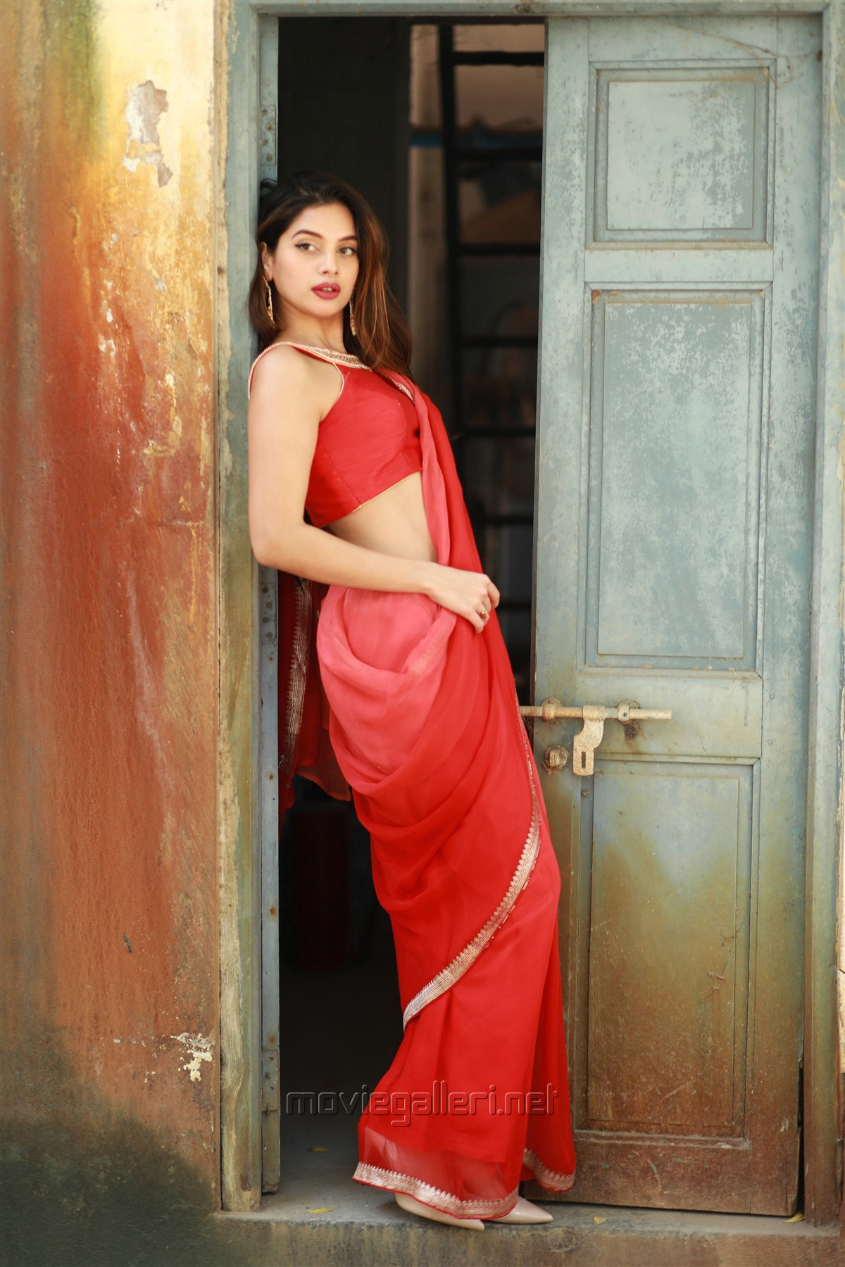 Actress Tanya Hope Hot Red Saree Photos @ Thadam Audio Launch