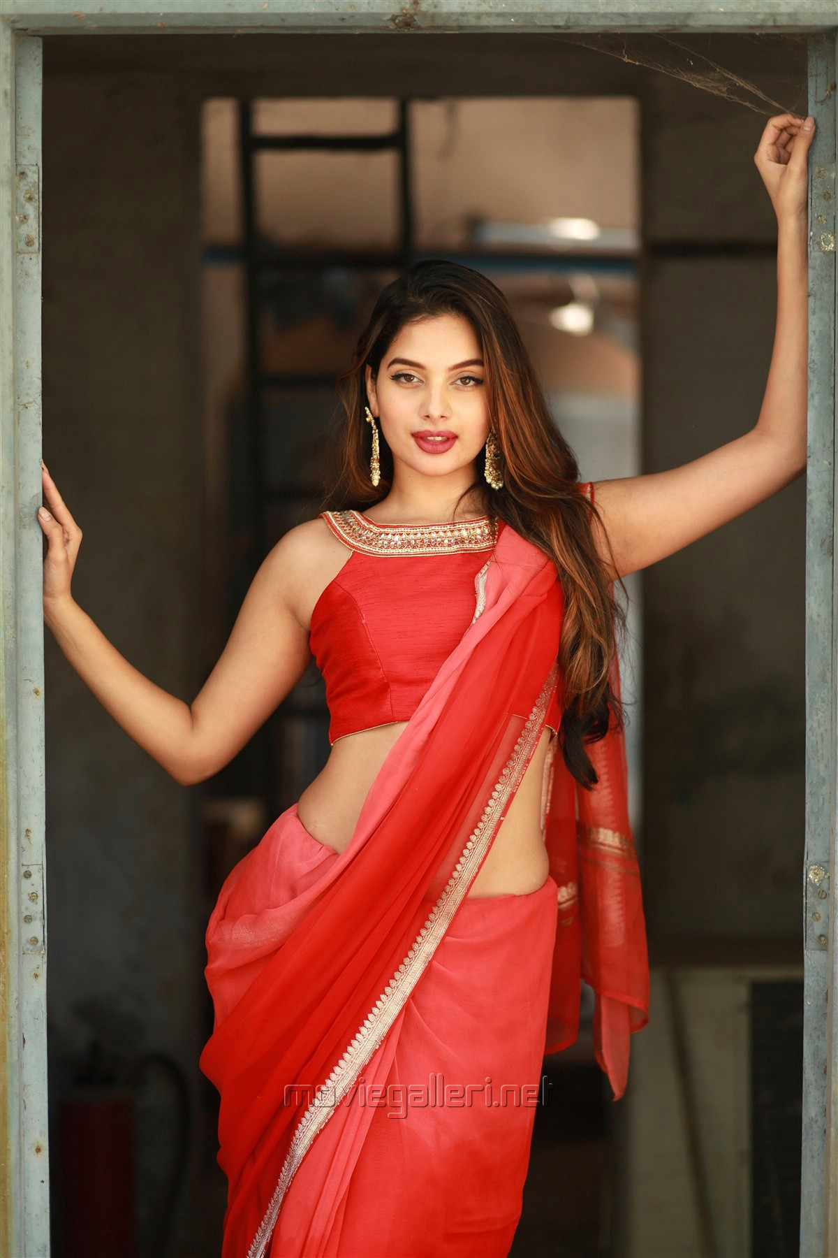 Actress Tanya Hope Red Saree Photos @ Thadam Audio Release
