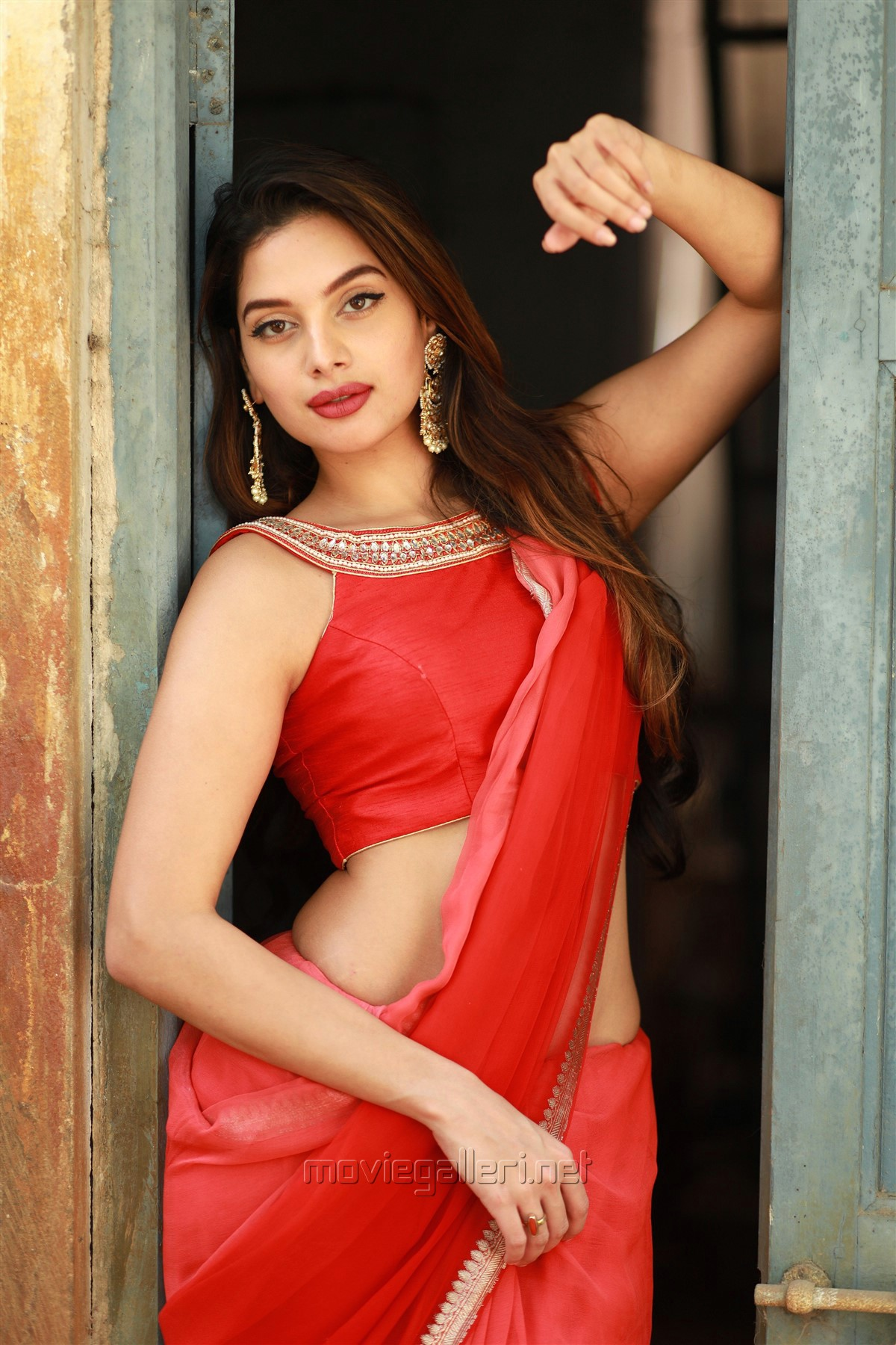 Actress Tanya Hope Hot Red Saree Photos @ Thadam Audio Launch