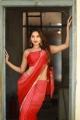 Thadam Movie Actress Tanya Hope Red Saree Photos
