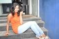 Tamil Actress Uthara Unni Stills in Orange Dress