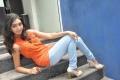 Tamil Actress Uthara Unni Stills in Orange Top & Jeans