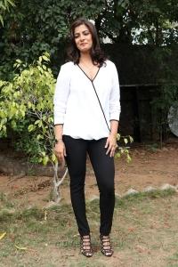 Actress Varalaxmi Sarathkumar Photos in White Top & Black Pant