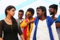 Nikki Galrani, Soori in Velainu Vandhutta Vellaikaaran Movie Stills