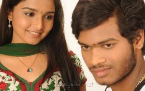 S.Sathish, Deepti Nambiar in Vellai Kagitham Movie Stills
