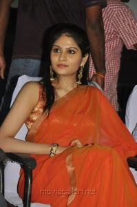 Mathil Mel Poonai Actress Vibha Natarajan in Orange Plain Saree