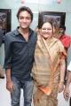 Nassar wife Kameela with son Faizal at Viswaroopam Premiere Show Chennai Photos