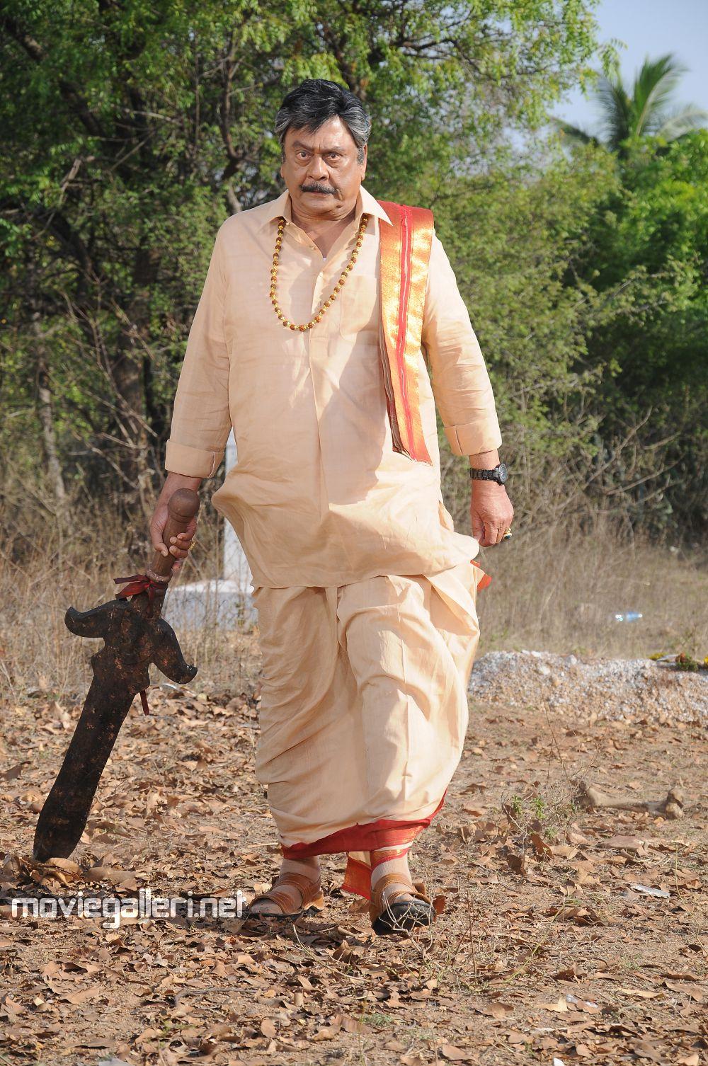 Krishnam Raju as Ashok Gajapathi Raju in Chandee Movie