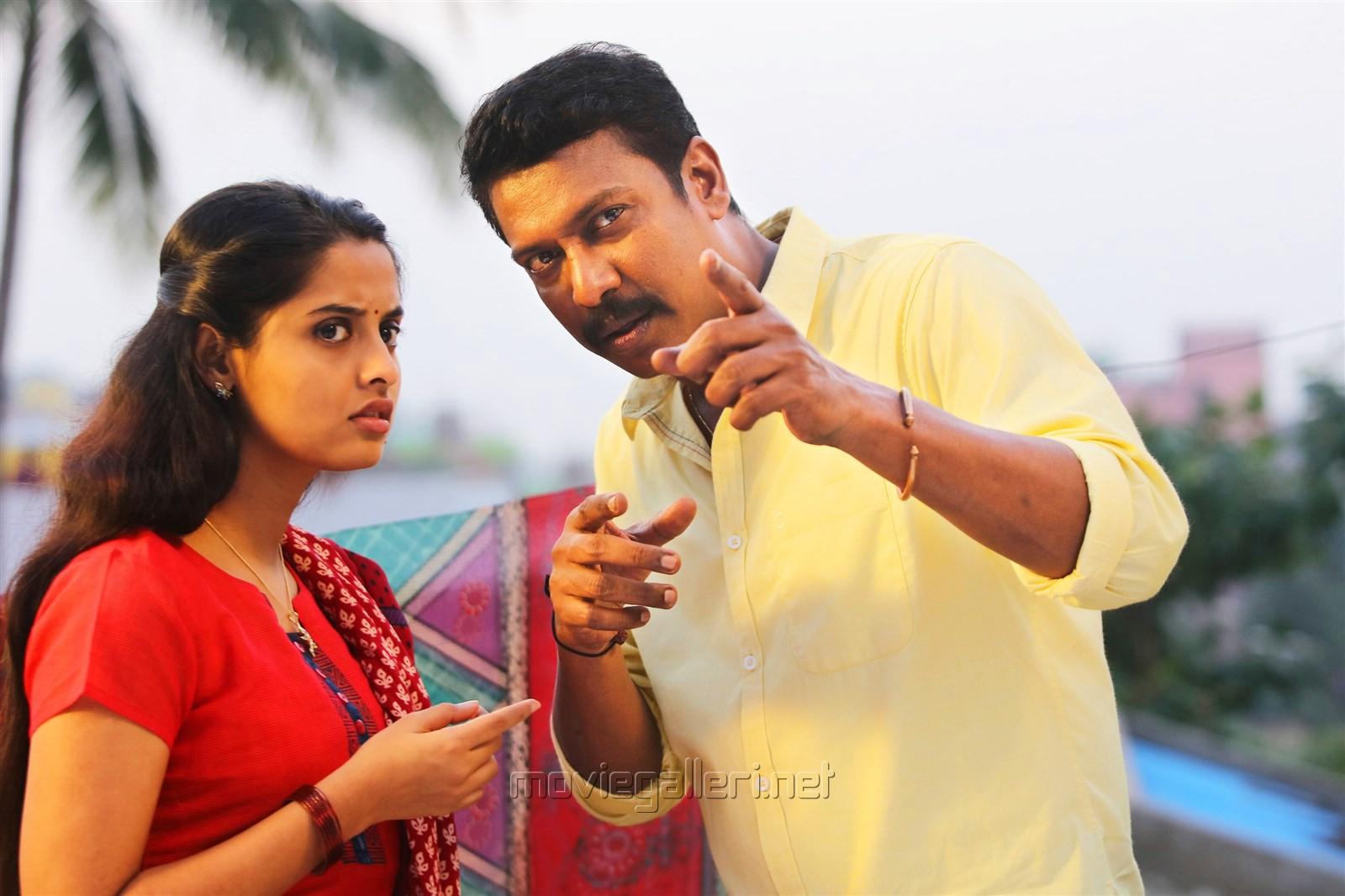 Arthana, Samuthirakani in Thondan Movie Stills