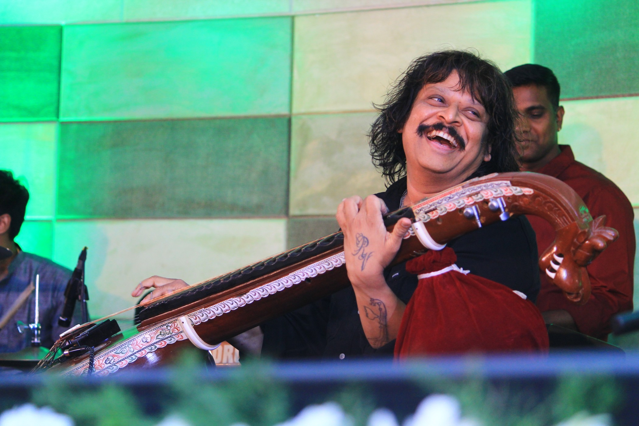 Veena Maestro Kalaimamani Rajhesh Vaidhya enters Asia Books of Records with 60 Song Snippets in an Hour