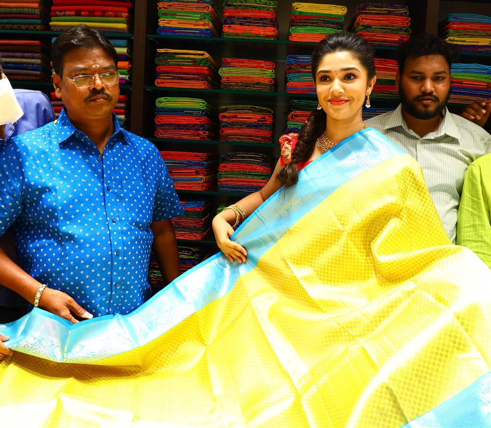 Uppena Fame Actress Krithi Shetty; looking at a saree after inaugurating the 10th Maangalya Shopping Mall in Hyderabad, at AS Rao Nagar