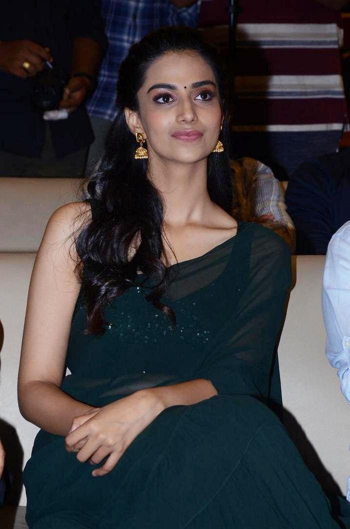Actress Meenakshi Chaudhary Green Saree Stills @ Ichata Vahanamulu Niluparadu Movie Pre Release